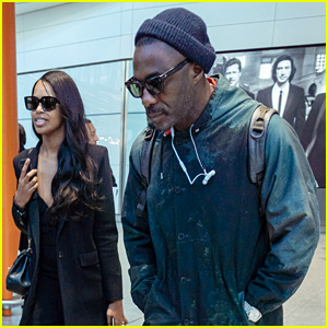 Idris Elba & Fiancee Sabrina Dhowre Land in London After Coachella