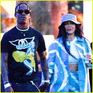 Kylie Jenner & Travis Scott Share Kiss Before Boarding Private Jet In New Photo