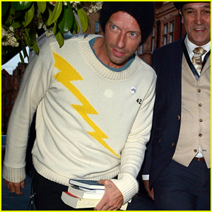 Chris Martin Brings Some Books to Dinner in London!