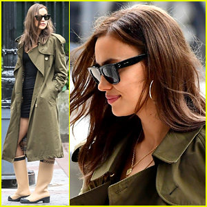 Irina Shayk Dons Green Coat & Chanel Boots for Rainy Day Out