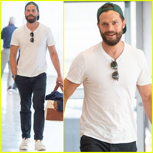 Jamie Dornan Is All Smiles While Jetting Out of New York City