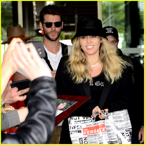 Miley Cyrus & Liam Hemsworth Swarmed By Fans in Poland