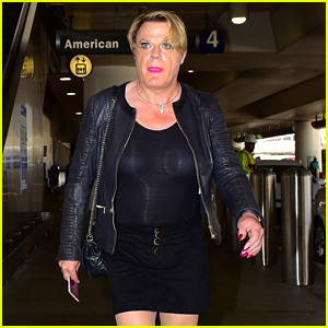 Eddie Izzard Struts Out of LAX in a Short Skirt & Stiletto Boots