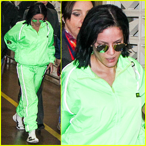 Halsey Dons Neon Green Outfit for Flight Out of Brazil