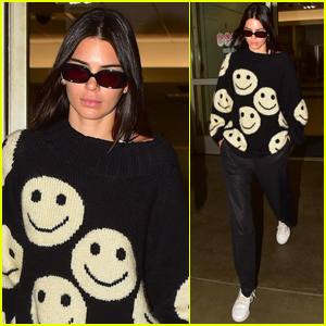 Kendall Jenner Sports Smiley Face Sweater For Flight Into LAX