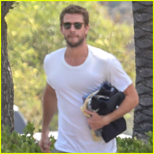 Liam Hemsworth Runs To The Store With His Wet Suit In Hand