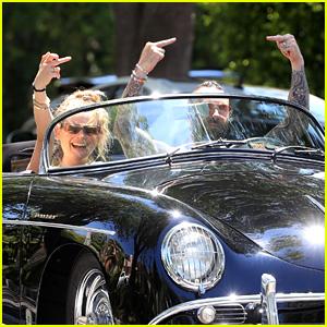 Adam Levine & Behati Prinsloo Flip Off the Cameras While Riding in Their Vintage Porsche