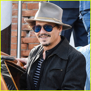 Johnny Depp is All Smiles as He Takes Water Taxi to Venice Airport