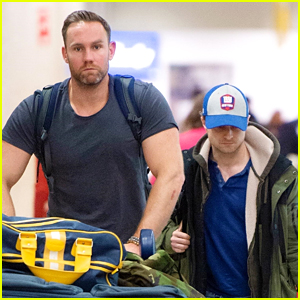 Daniel Radcliffe Arrives at JFK Airport With A Super Hot Bodyguard