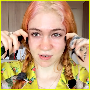 Grimes Reveals What Pregnancy Is Doing to Her Hair & Skin (Video)