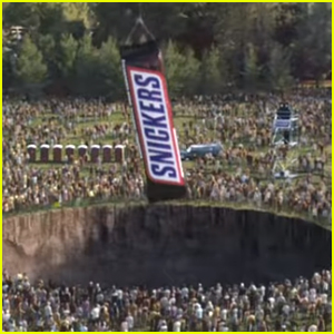 Snickers' Super Bowl 2020 Commercial Aims To Fix The World By Feeding The World a Giant Bar