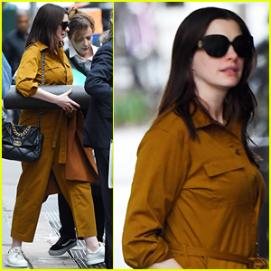 Anne Hathaway Carries a Foam Roller While Out With Friends