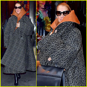 Celine Dion Braves the NYC Rainstorm in an Oversized Raincoat