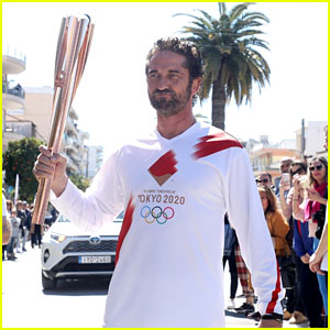 Gerard Butler Lights the Olympic Torch During Event in Sparta!