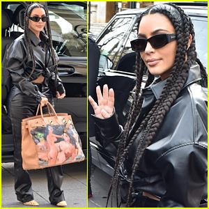 Kim Kardashian Sports Black Leather Look With Snakeskin-Print Boots While Leaving Paris