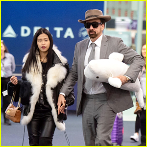Nicolas Cage Carries a Beluga Whale Toy With New Girlfriend Riko Shibata at the Airport in NYC