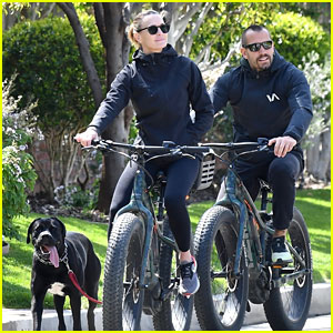 Robin Wright & Husband Clement Giraudet Go For a Bike Ride with Their Dog