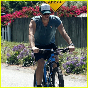 Chris Martin Shows Off His Muscles on a Bike Ride in Malibu