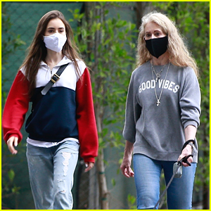 Lily Collins Goes for a Masked Stroll with Her Mom & Dog