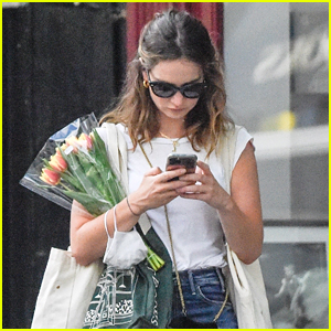 Lily James Buys A Bouquet of Tulips While Out in London