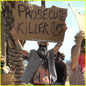 Machine Gun Kelly Holds 'Prosecute Killer Cops' Sign During Protest in LA