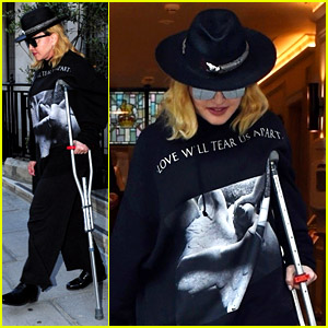 Madonna Leaves the Hospital Using a Crutch While Recovering from Injuries