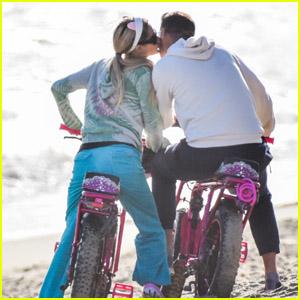 Paris Hilton & Boyfriend Carter Reum Pack on the PDA While Riding Electric Bikes in Malibu