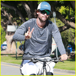 Patrick Schwarzenegger Throws Up the Peace Sign on Bike Ride