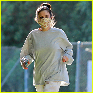 Selena Gomez Goes For a Masked Stroll With a Friend