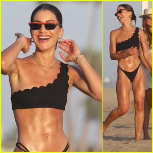 Camila Coelho Stuns in a Black Bikini at the Beach With Friends