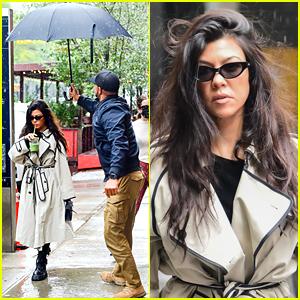 Koutney Kardashian Gets Assist from an Umbrella Holder in Rainy New York City
