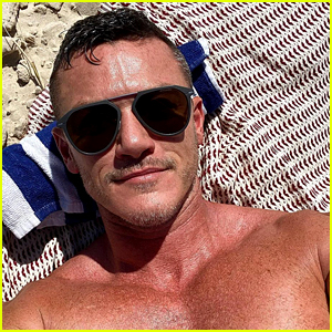 Luke Evans Shares Hot New Shirtless Selfie While at the Beach in Australia