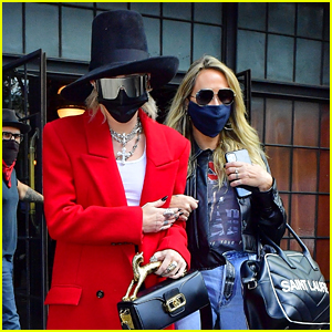 Miley Cyrus Is Fashion Forward In a Top Hat & Red Coat in New York City