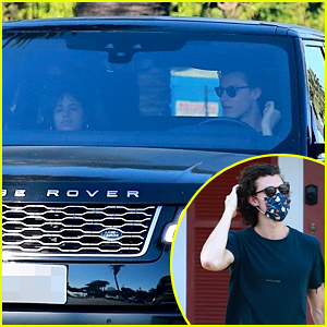 Shawn Mendes Picks Up a Camera While Camila Cabello Waits in the Car