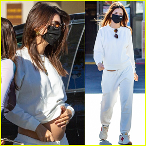 Emily Ratajkowski Cradles Baby Bump While Out with Friends