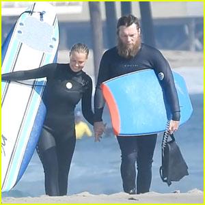 Sam Worthington Sports Shaggy Beard While Surfing With Wife Lara Worthington