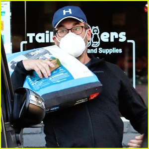 Jon Hamm Shows Off His Strength While Lifting Heavy Bag of Dog Food