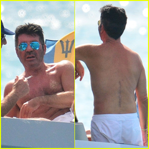 Simon Cowell Puts Back Scars on Display After Scary Bike Accident