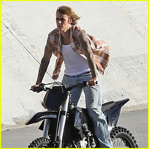 Justin Bieber Rides a Motorcycle While Seemingly Filming a New Music Video (Photos)