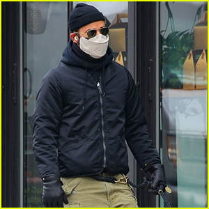 Justin Theroux Rocks Leather Gloves During Walk with His Beloved Dog Kuma