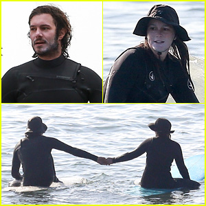 Leighton Meester & Adam Brody Adorably Hold Hands While Riding Their Surfboards in the Ocean