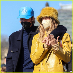 Justin & Hailey Bieber Cuddle Up on a Romantic Stroll Through Paris