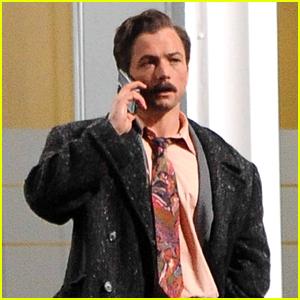 Taron Egerton Debuts His New Look With A Mustache on 'Tetris' Movie Set