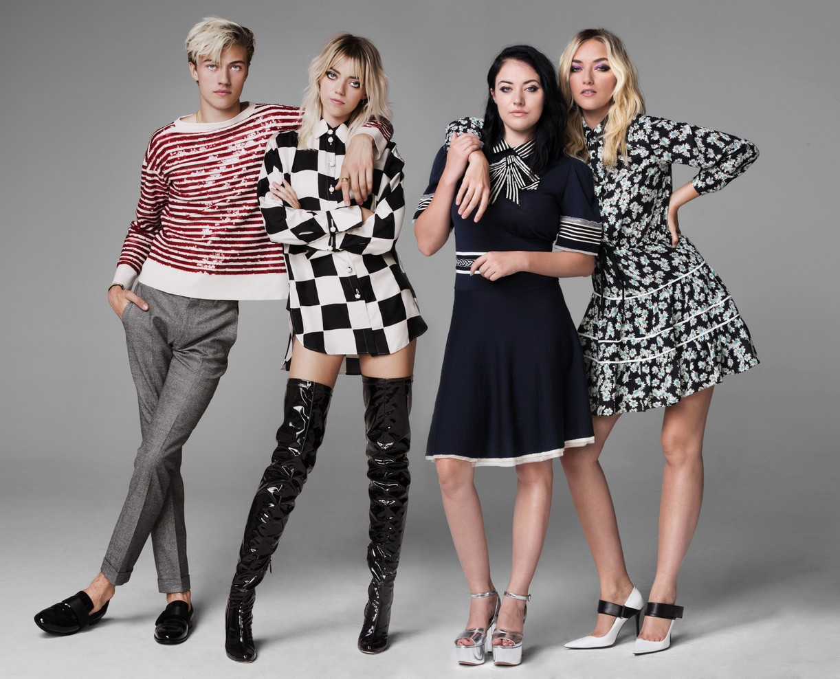 The four siblings of The Atomics pose for a group portrait