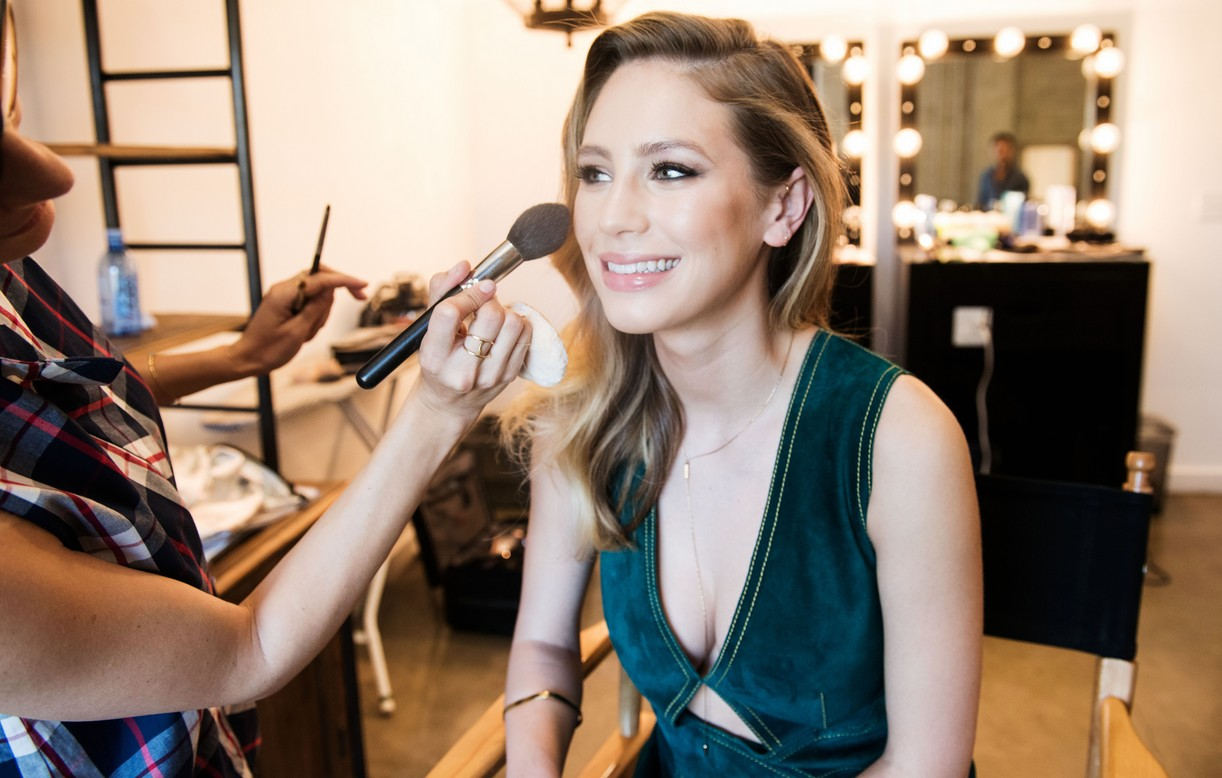Dylan Penn Behind The Scenes getting blush on her cheeks