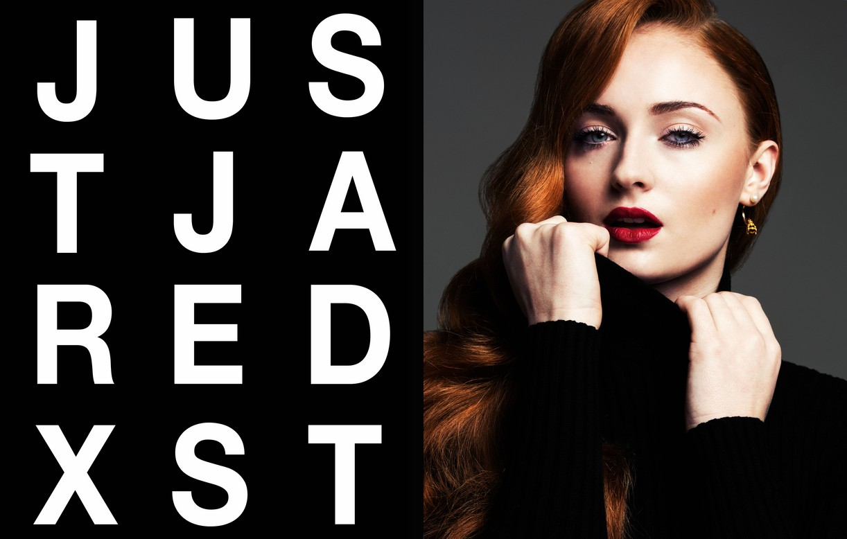 Sophie Turner pulls up her turtleneck sweater in stunning color portrait